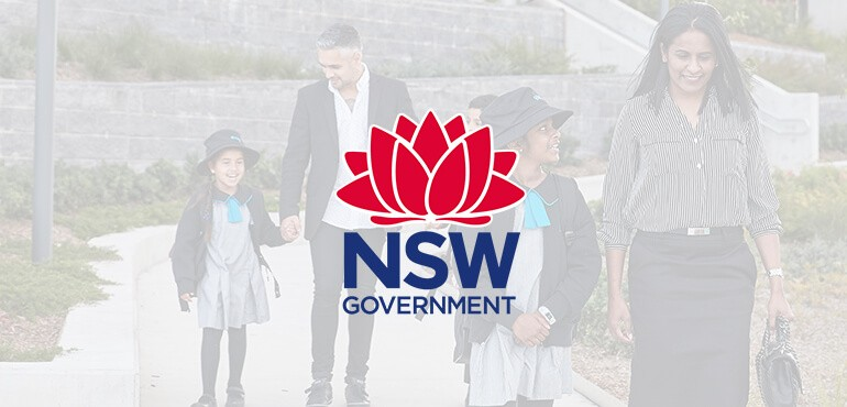 Mother and father walking with their children. NSW Government logo.